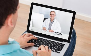 A patient teleconferencing with a doctor, one of today's growing healthcare trends.